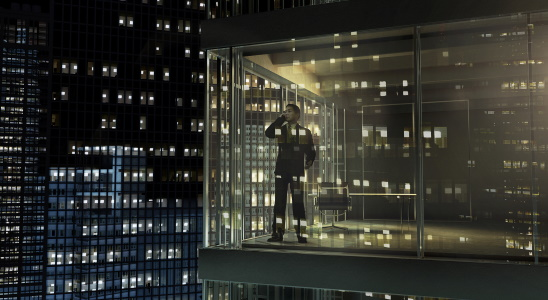 Businessman standing and talking on mobile phone in office by night