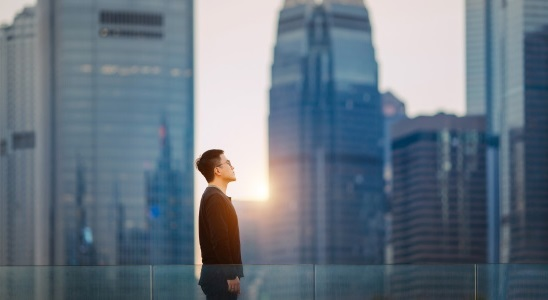 Man on a fresh bright morning against cityscape