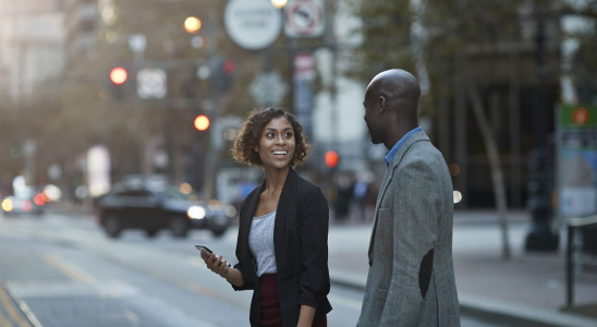 Businesspeople walking and talking on avenue of San Francisco, USA