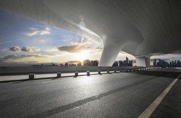 Empty road with city skyline
